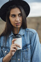 Portrait of young woman drinking beverage - VPIF00896