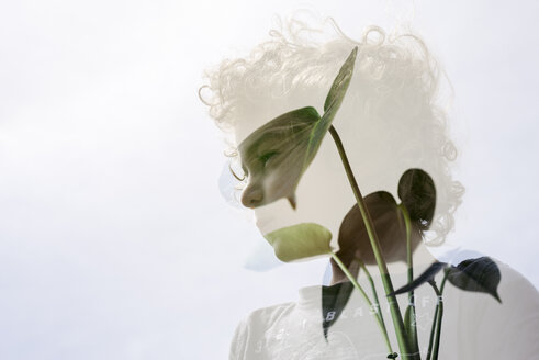 Double exposure of thoughtful boy and plants against clear sky - CAVF49025