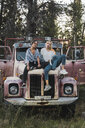 Two friends sitting on a broken truck - KKAF02204