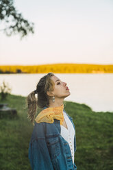 Portrait of a beautiful young woman at a lake - KKAF02228