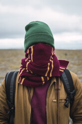 Young man with woolly hat and scarf, wrapped around face - KKAF02297