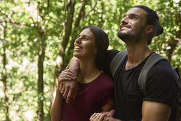 Spain, Canary Islands, La Palma, happy couple standing in a forest looking up - PACF00149