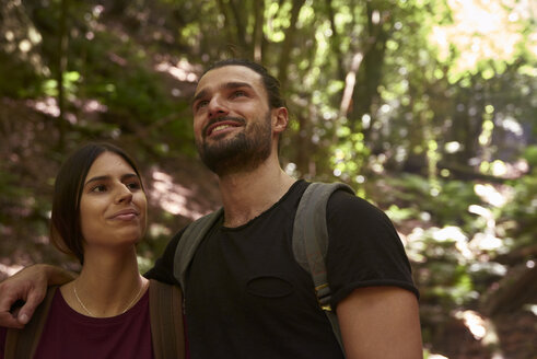 Spain, Canary Islands, La Palma, smiling couple in a forest looking around - PACF00155