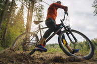 Athlete mountainbiking in the woods - KKAF02372