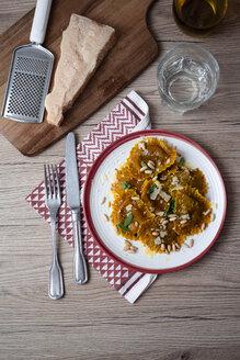 Plate of pumpkin ravioli with sage leaves, parmesan and pine nuts - GIOF04549