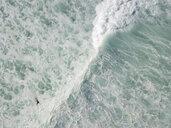 Indonesia, Bali, Aerial view of Balngan beach, surfer - KNTF01935