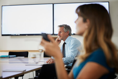 Colleagues in meeting in boardroom - CUF44025