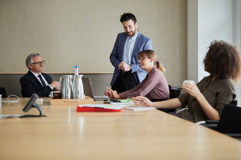 Colleagues in meeting in boardroom - CUF44043