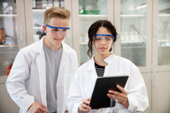 Students using digital tablet in laboratory - CUF44178