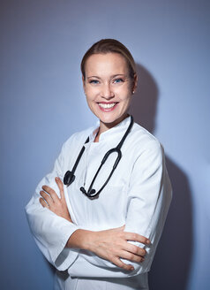Portrait of smiling female doctor with stethoscope - PNEF01000