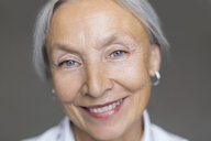 Portrait of smiling senior woman with grey hair and blue eyes - VGF00015