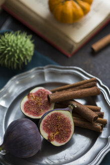 Still life with figs and cinnamon sticks on tray - JUNF01399