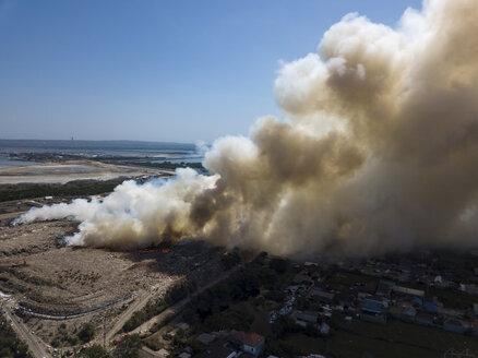 Indonesia, Bali, Aerial view of Sanur, fire, smoke - KNTF01959