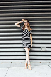 Portrait of young woman wearing striped dress - GIOF04581