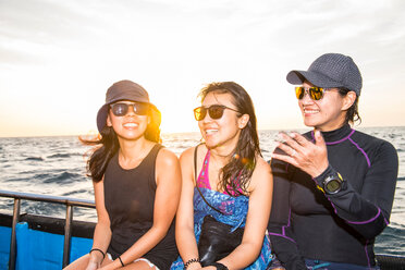 Three friends on boat, Cagayancillo, Palawan, Philippines - CUF44278