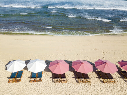 Indonesia, Bali, Aerial view of Balangan beach, sunloungers and beach umbrellas - KNTF02056