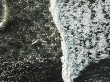 Indonesia, Bali, Aerial view of surfer at Yeh Gangga beach - KNTF02071