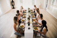 Women enjoying friendship and meal in yoga retreat - CUF45024
