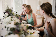 Women enjoying friendship and meal in yoga retreat - CUF45027