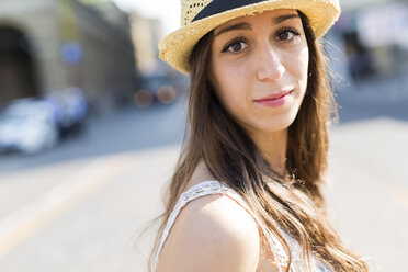 Portrait of young woman wearing straw hat - GIOF04699
