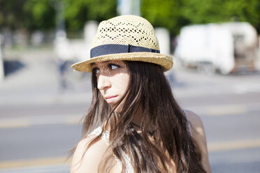 Portrait of young woman wearing straw hat - GIOF04711