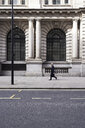UK, London, senior businessman walking on pavement - IGGF00616