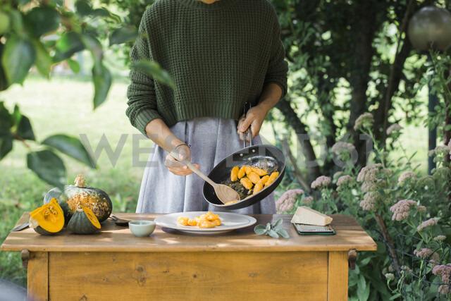 Young woman with homemade pumpkin gnocchi, partial view - ALBF00615 - Alberto Bogo/Westend61