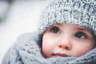 Close up portrait of a cute baby in the snow - INGF00025