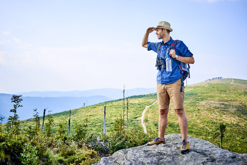 Man admiring the mountain view during hiking trip - BSZF00707