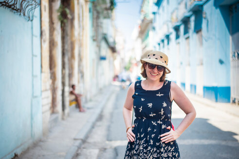 Portrait of a young woman standing in a street in Cuba - INGF00287