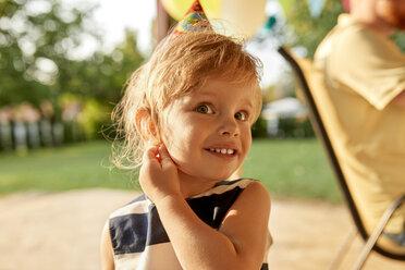 Portrait of little girl on a birthday garden party - ZEDF01651