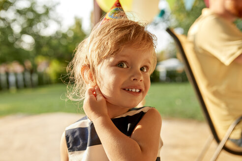 Portrait of little girl on a birthday garden party - ZEDF01651
