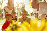 Happy extended family on a garden birthday party - ZEDF01663