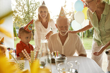 Happy extended family on a garden birthday party - ZEDF01669