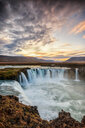 Scenic view of a waterfall at sunset out in nature - INGF00372