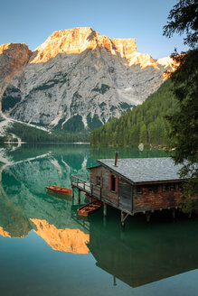 Beautiful nature scene of a river hut overlooking the mountains in the Italian Alps - INGF00393