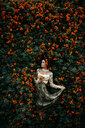 A woman embracing nature in a flowering tree - INGF00459