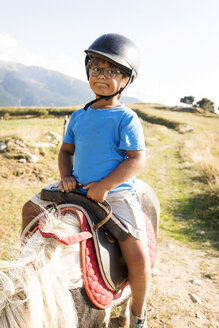 Spain, Cerdanya, portrait of little boy riding on pony - VABF01632