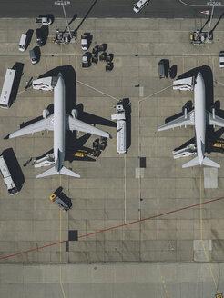 View from above commercial airplanes being serviced, prepared on tarmac at airport - FSIF03190