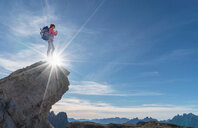 Hiker enjoying view, Dolomites near Cortina d'Ampezzo, Veneto, Italy - CUF45411