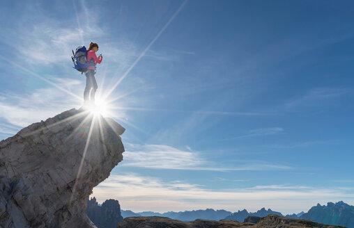 Hiker enjoying view, Dolomites near Cortina d'Ampezzo, Veneto, Italy - CUF45411
