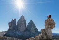 Hiker enjoying view, Dolomites near Cortina d'Ampezzo, Veneto, Italy - CUF45414