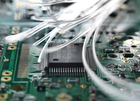 Fibre optics carrying data passing through a circuit board to illustrate artificial intelligence - CUF45546