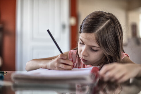 Girl writing at table - CUF45819