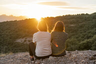 Friends watching sunset from a mountain - AFVF01651