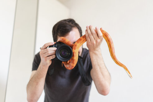 Snake slithering around camera of a man - AFVF01708
