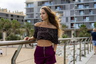 Portrait of beautiful young woman standing on promenade - AFVF01709