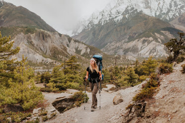 Hiker on trail, Annapurna Circuit, the Himalayas, Manang, Nepal - ISF19927