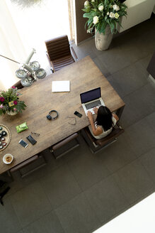 Overhead view of woman using laptop at home - HHLMF00529