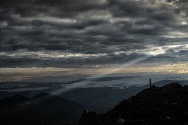 Russia, Upper Baksan Valley, Caucasus, Mount Elbrus, Mountaineer looking down from North Camp - ALRF01281